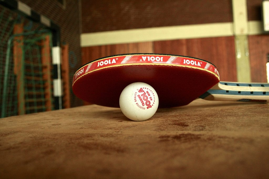 table tennis racket and ball on a table